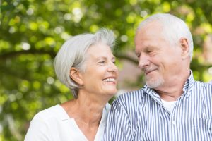 older couple smiling at the park